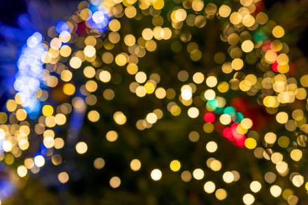 Bright bokeh from the lights of the Christmas tree 免版税图像