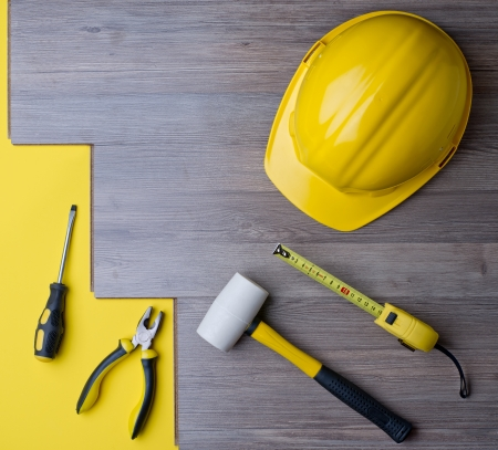 laminate and tools with a yellow helmet Standard-Bild