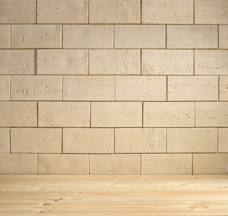 beige brick background, the wall and the wooden floor photo