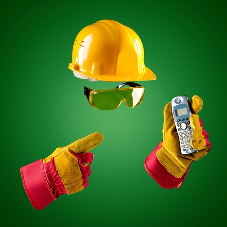 maintenance fitter: invisible builder — phone on a green background Stock Photo