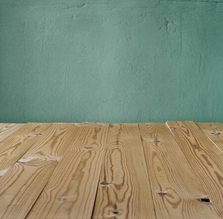 vintage background of the old wall and wood table