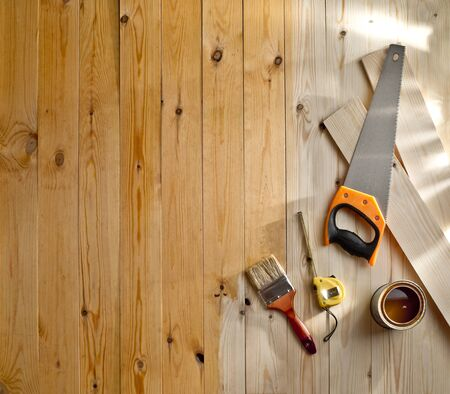 wood floor with a brush, paint and tools photo