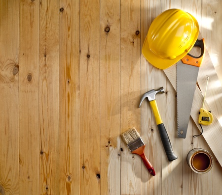wood floor with a brush, paint, tools and helmet Stock Photo - 19140527