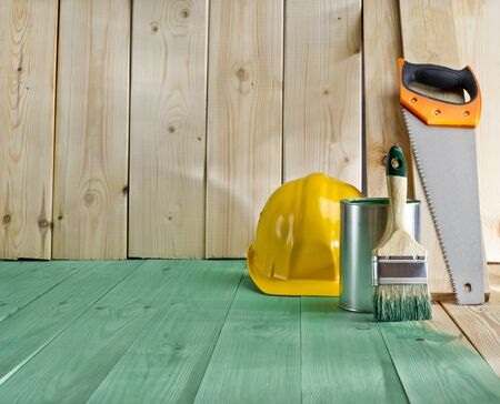 green wood floor with a brush, saw and helmet Stock Photo - 19666832