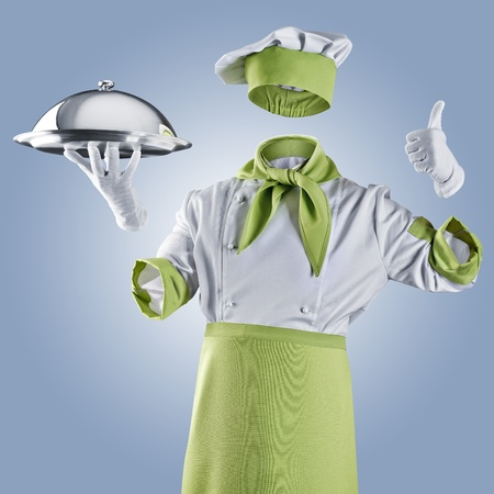 invisible chef with restaurant cloche or tray on a blue background photo