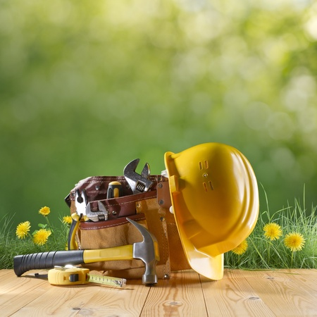 construction tool and helmet on green nature background Stock Photo