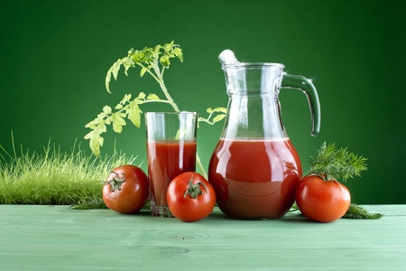 fresh tomato juice on a background of nature