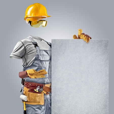 erector: invisible builder shows information poster on grey background Stock Photo
