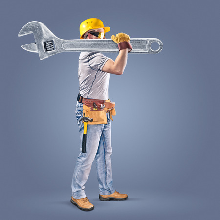 construction worker with a tool belt and a wrench