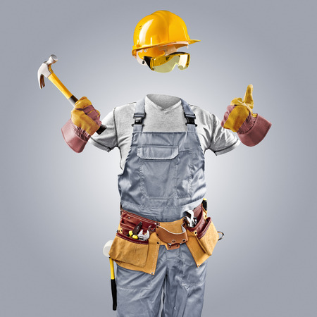 invisible worker in helmet with hammer photo