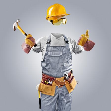 invisible worker in helmet with hammer Standard-Bild