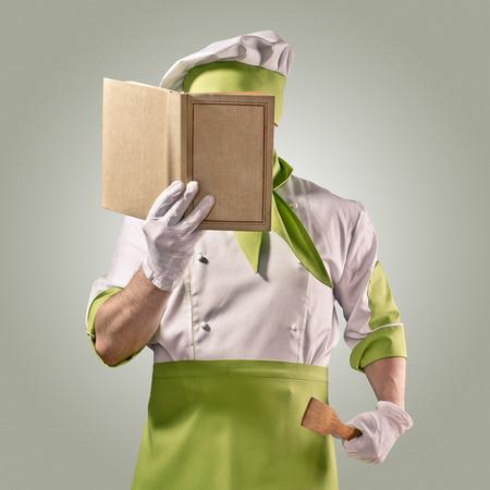 chef cocinando: chef con libro de cocina Foto de archivo