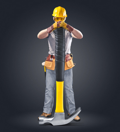 mounter: construction worker in helmet with tool and hammer Stock Photo