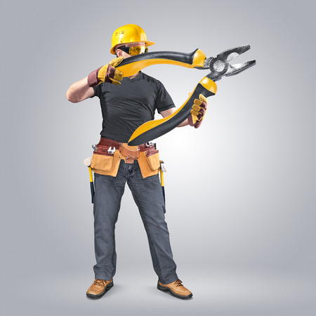 construction worker with tool belt and pliers Stock Photo