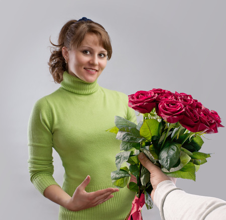 girl presented with a bouquet of flowers photo