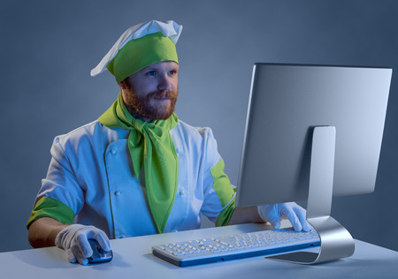 cook chef working at a computer with keyboard and mouse, purchase in online store