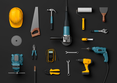 carpenter vise: helmet, drill, angle grinder and construction tools on a black isolated background Stock Photo