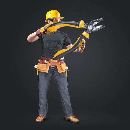 construction worker with tool belt and pliers on dark background