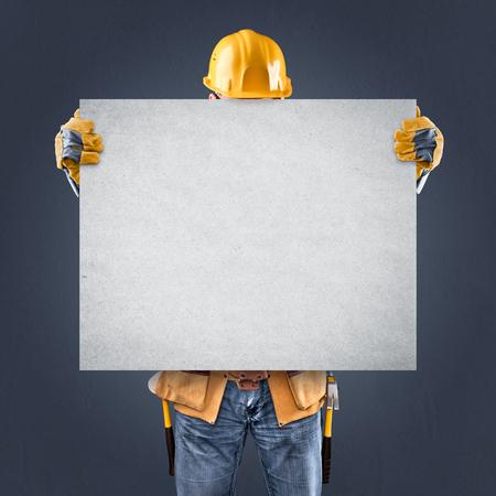 background information: construction worker with information posters on a blue background