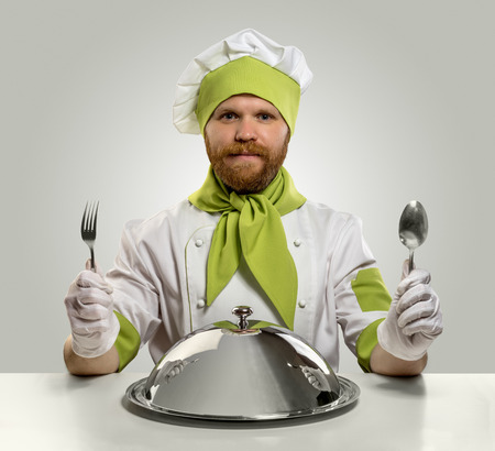 cook chef with fork, spoon and food tray on isolated background
