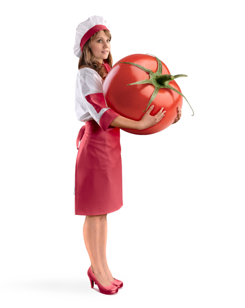 cook girl chef holding a large tomato on white isolated background