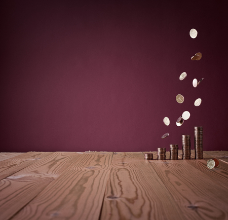 vintage money rain against the red background of the old wall and wood table