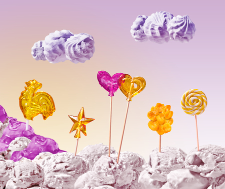 sweet landscape of ice cream and candy on pink sky background