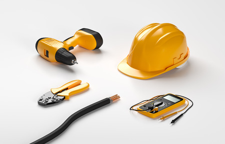 crimping: electric screwdriver, helmet, crimping pliers and digital multimeter on isolated background