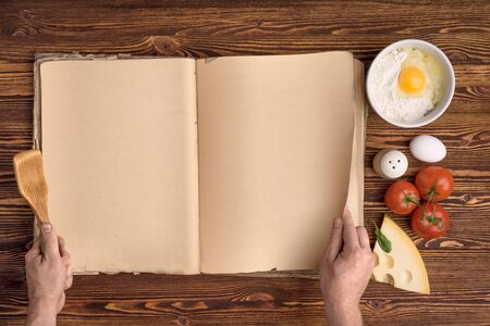 hand chef, cook book, ingredients on the background of vintage wood