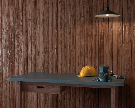 work table of a carpenter on wooden wall background