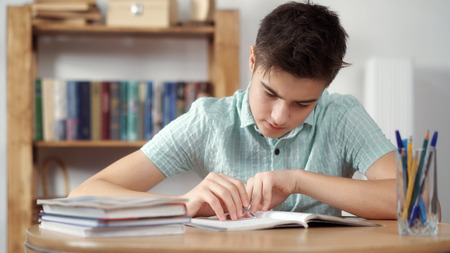 Boy thinks and does the lessons Stock Photo