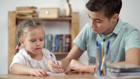 Teenager and girl learning Stock Photo