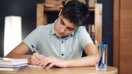 Teenager makes lessons and writes