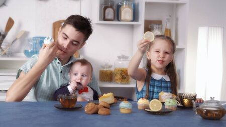 funny kids eat sweets Stock Photo