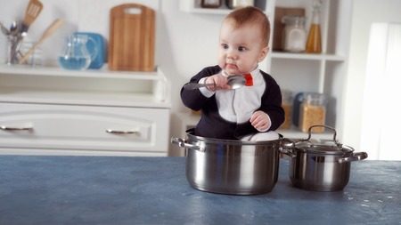 baby chef sitting in a pot
