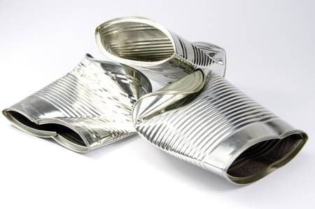crushed aluminum cans: 3 crushed tin cans on white background Stock Photo