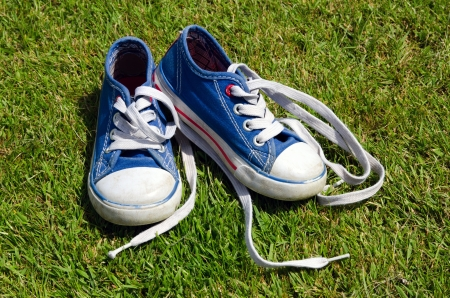old sneakers on grass background photo