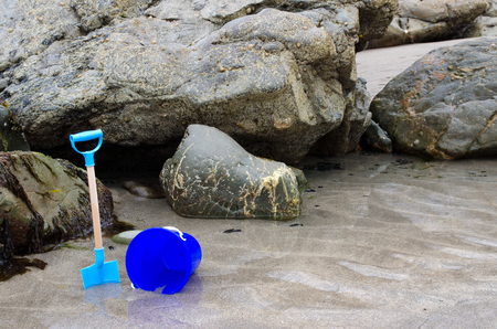 Child s bucket and spade on a beach photo