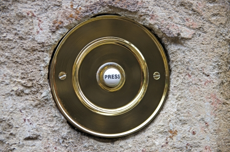 Circular brass door bell photo