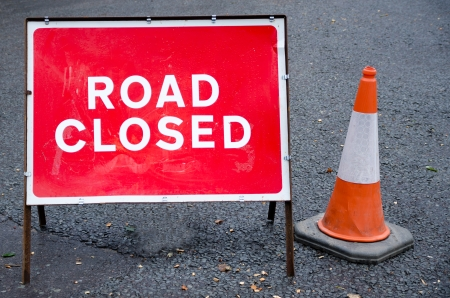 Road closed sign with traffic cone Stok Fotoğraf