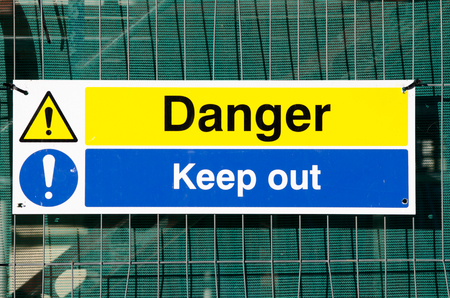 fenced: Construction site danger keep out sign Stock Photo