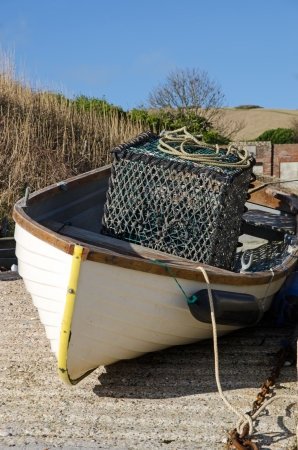 crab pot: Small fishing boat with crab pot Stock Photo
