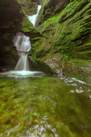 St.Nectan's waterfall is in a designated Site of Special Scientific Interest (SSSI), it has been described as amongst the ten most important spiritual sites in the country. A place of outstanding natural beauty.  The magic and tranquility of St Nectan's K Stock Photo