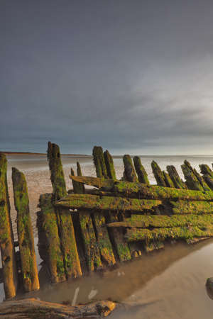 barque: The 1897 Norwegian barque SS Nornen on the beach at Berrow, Somerset,