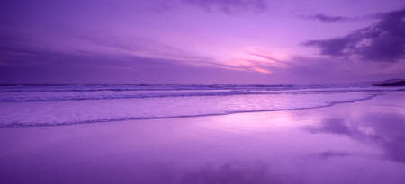 Sunset reflections on Whitsand Bay, Cornwall, UK Stock Photo - 13828405