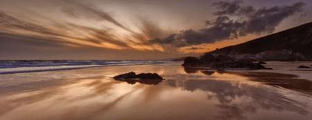 Sunset reflections on Whitsand Bay, Cornwall, UK