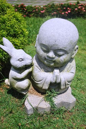 stone carving: Little Monk and Rabbit Stone Carving
