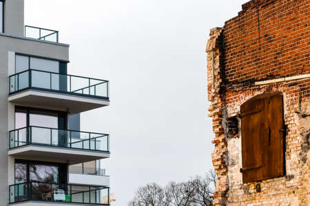 old brick house vs. new grey house Stock Photo
