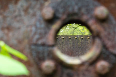 old rusty tank with a hole