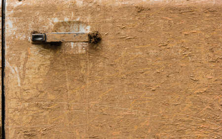 muddy car door with door handle close up Stock Photo